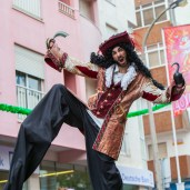 Bam! Pirate dude strikes a pose on stilts