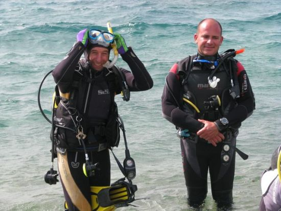 Exiting the water at Sporting Beach with my instructor Vincenzo after completing some diving exercises.