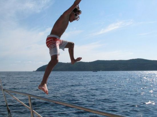 Sol jumping off the boat.
