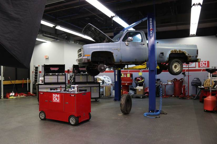 Chevy C10 square body up on a lift