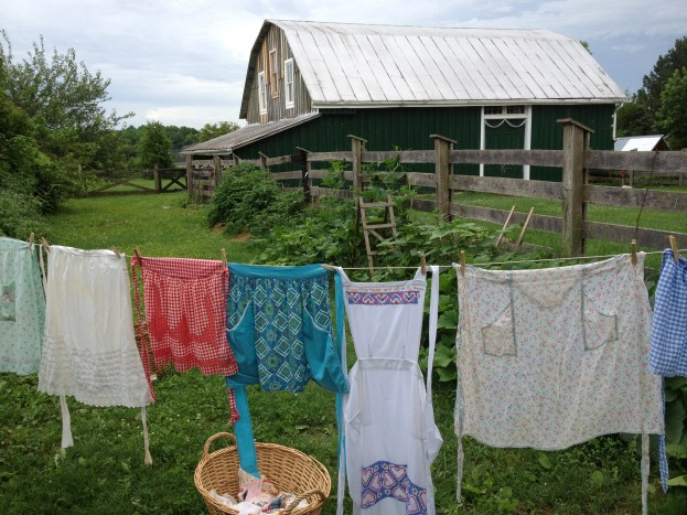 My vintage aprons hanging on clothesline