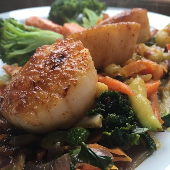 Seared Scallops over Sautéed Veggies