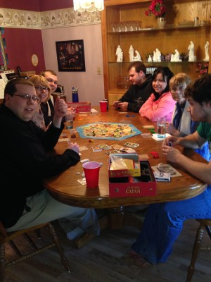 The whole gang playing Settlers of Catan