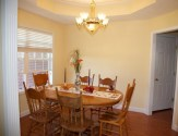 Formal dining area with autumn decor.