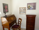 Sharon's vanity, pretty chair, and jewelry cabinet. Yes, I love earrings!
