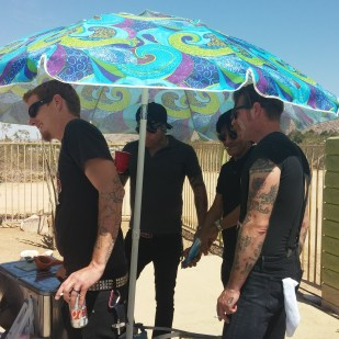 Men in Black in 105 degree heat. Pool party at the Joshua Tree Inn