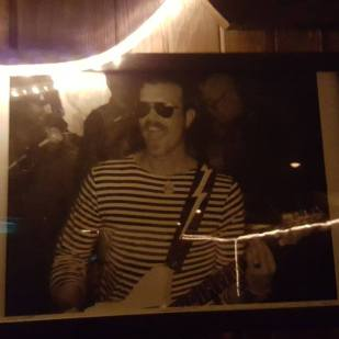 Photo of Jesse Hughes on the wall at Pappy & Harriet's c. 2006?