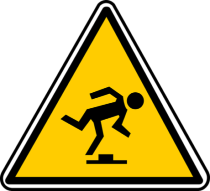 yellow triangle warning sign with a silhouette in black tripping and falling forward