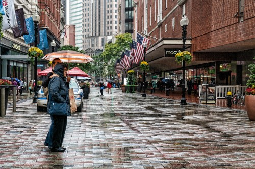 People on rainy street in Boston