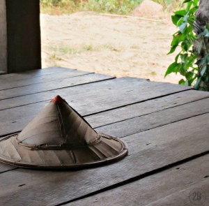 Bamboo hat resting on the porch of our guest home in Thailand. The farmer and his family graciously welcomed us in their home for an evening along the border.