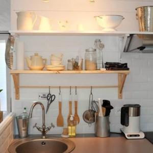 detail shot of kitchen utensils hung over sink