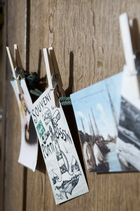 postcards hung on a line