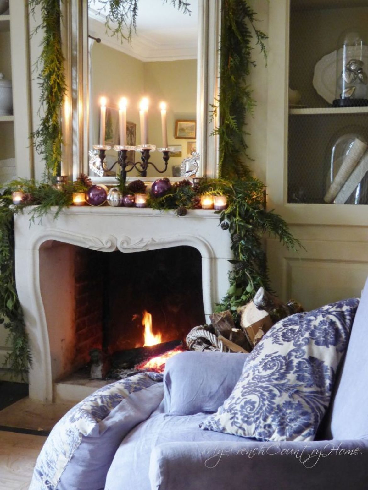christmas decor around the fireplace - French Country Christmas Decor