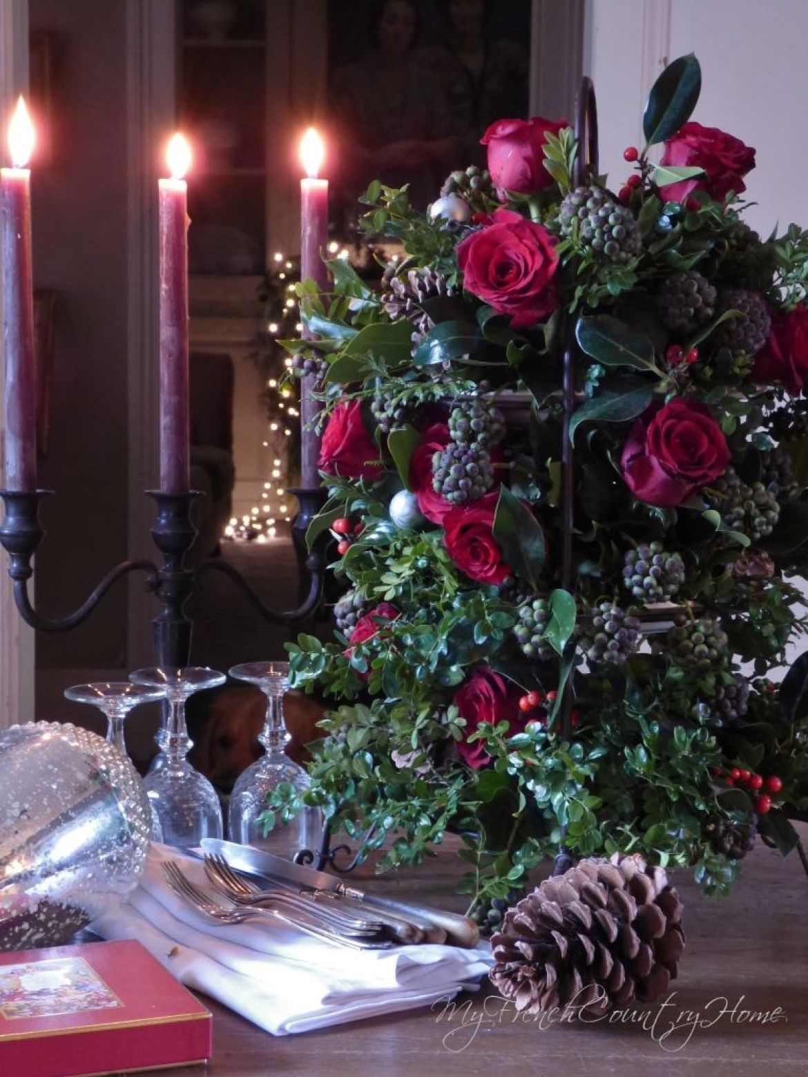 red roses arranged for a christmas bouquet