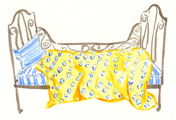 watercolour iron bed with quilt