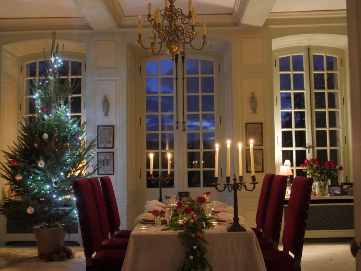 a holiday table laid in a french chateau