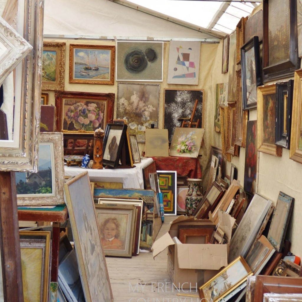 art for sale at an antique fair
