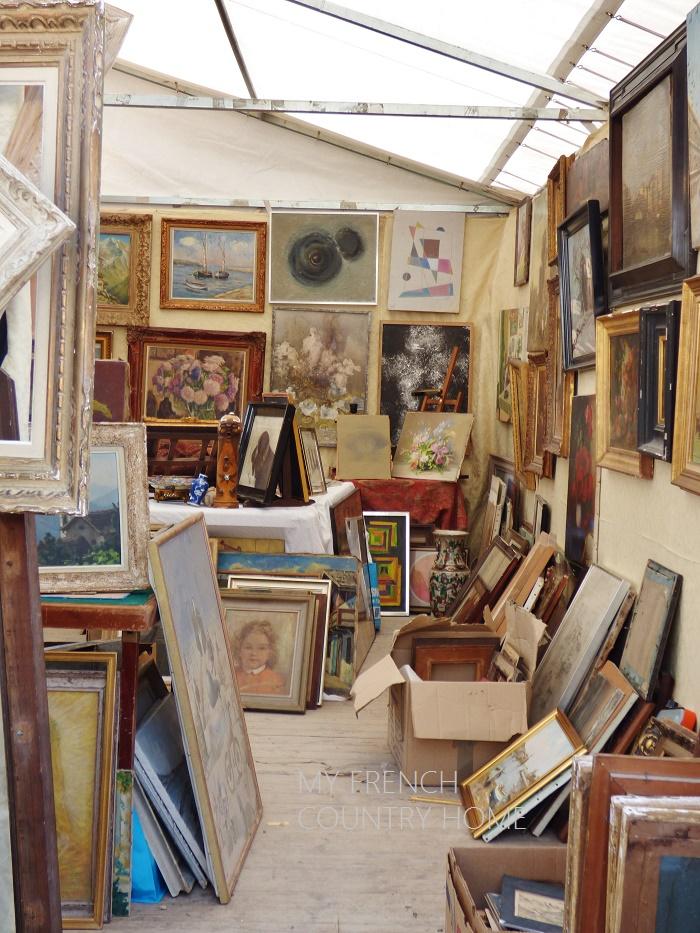 art for sale at an antique fair