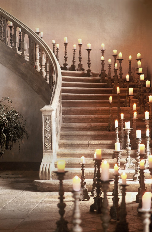 candles in stone staircase chateau de moissac