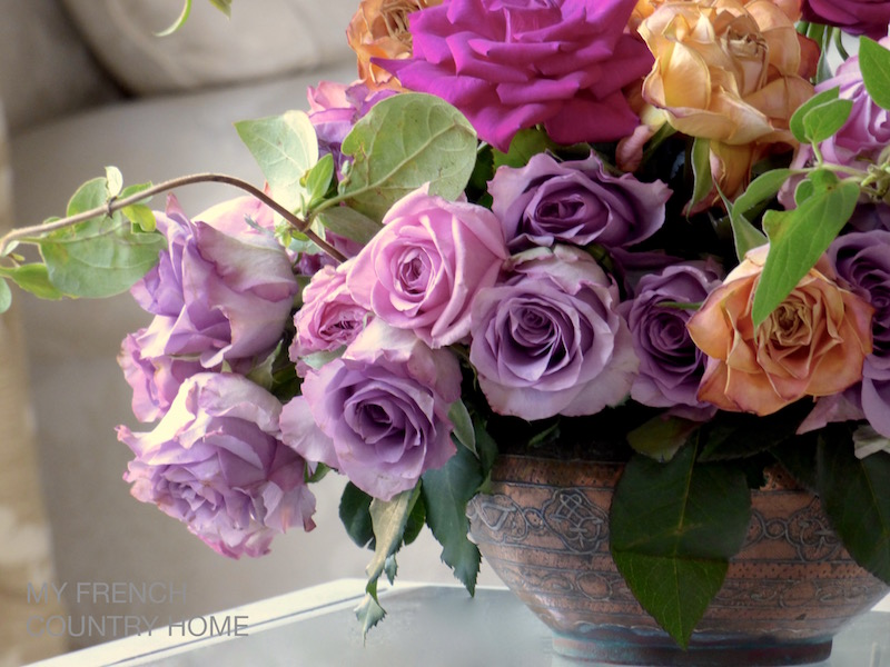 roses in copper bowl