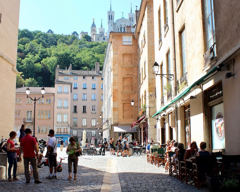 visiting lyon My French Country Home outdoor square with Basilica in the background