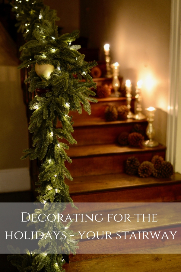 faux garland and candles on wooden staircase - decorating for the holidays