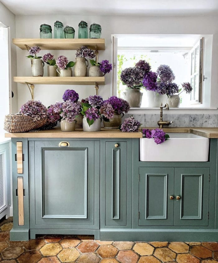 teal cabinets with beautiful bouquets of purple flowers