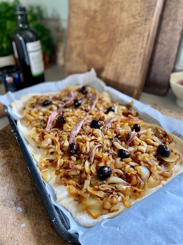 french onion tart with anchovies and olives