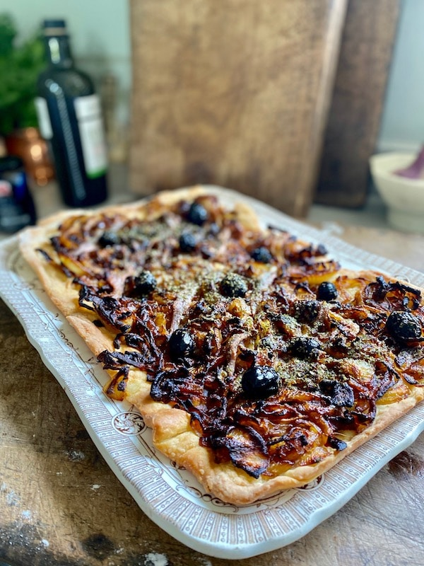 french onion tart on antique plate