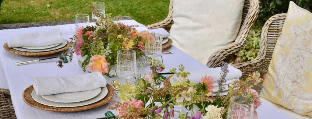 outdoor tablescape with crystal and flowers