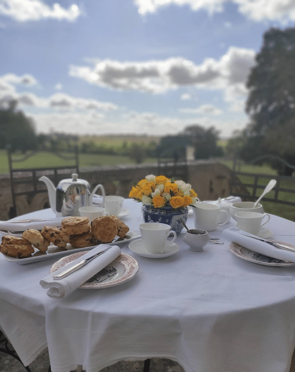 breakfast table with settings and a view