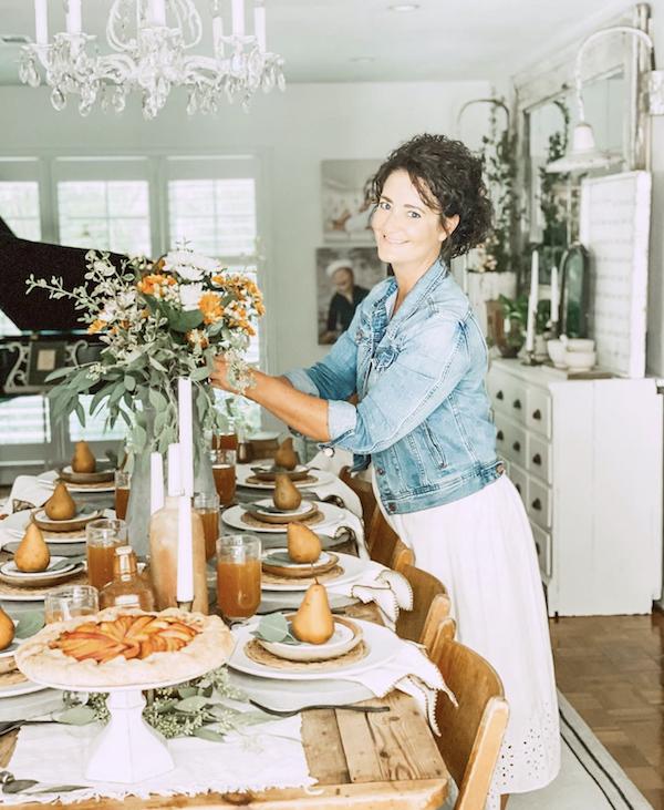 woman arranging tablescape