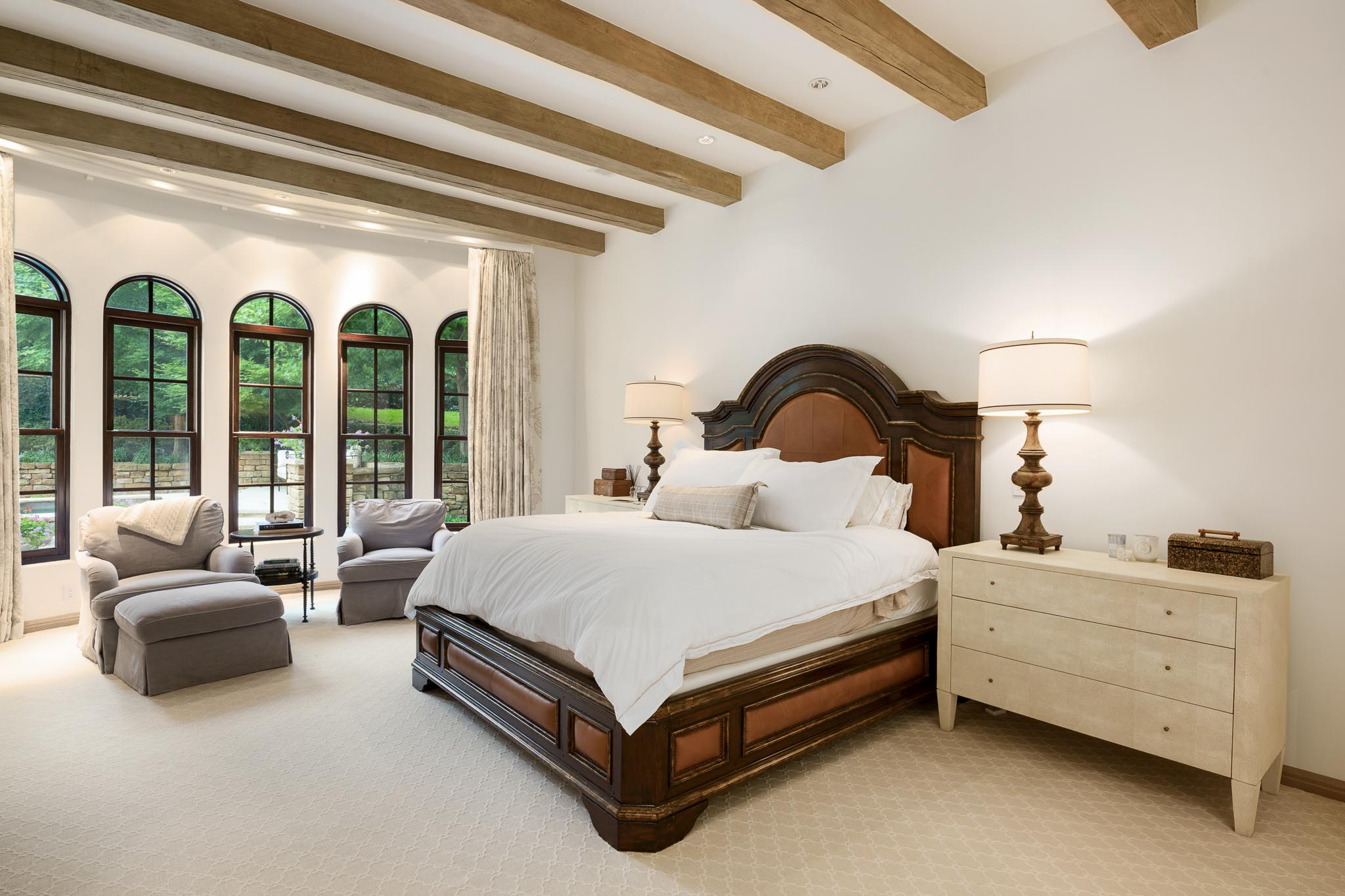 Master suite with wood beams