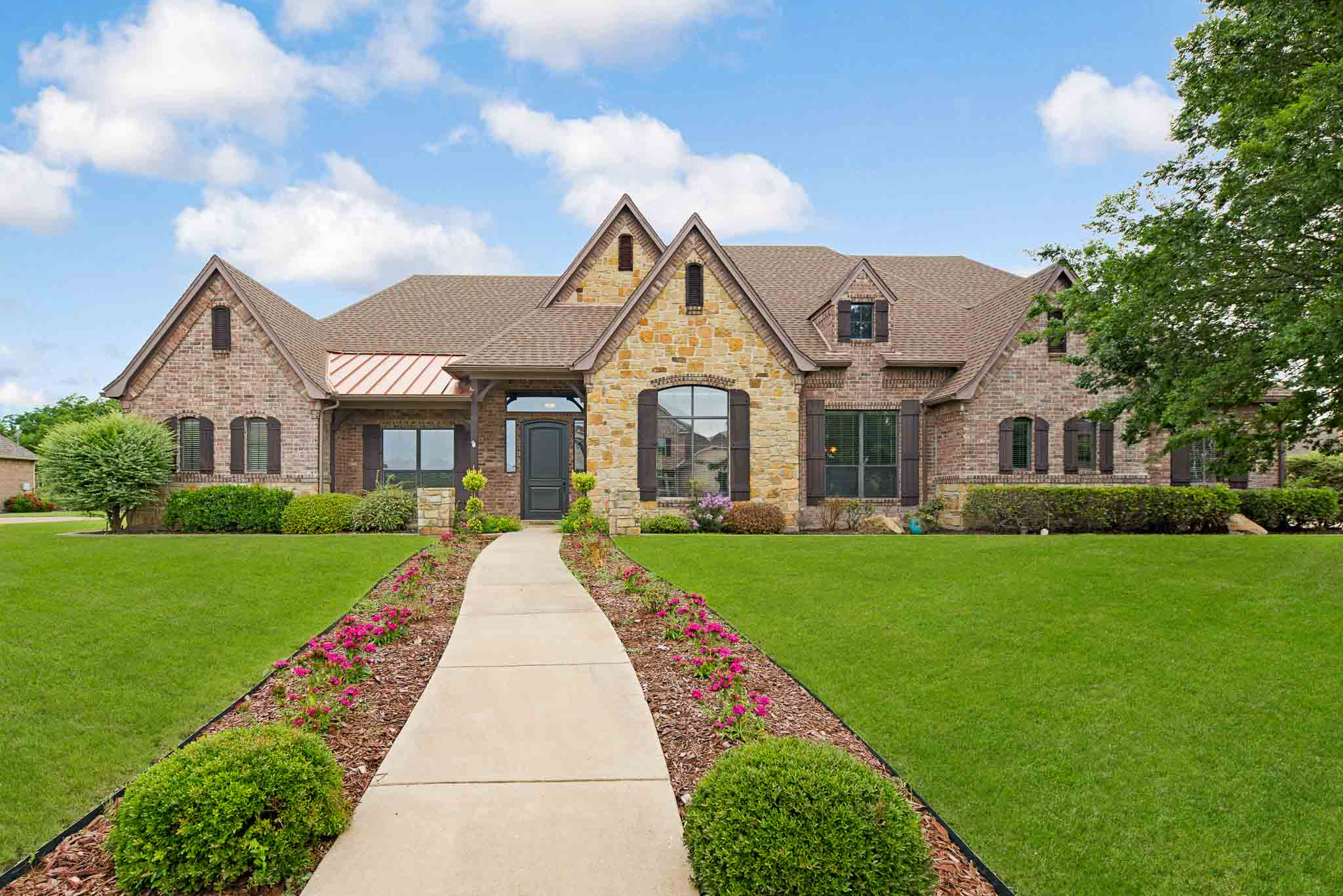 Home on golf course photographed near Fort Worth