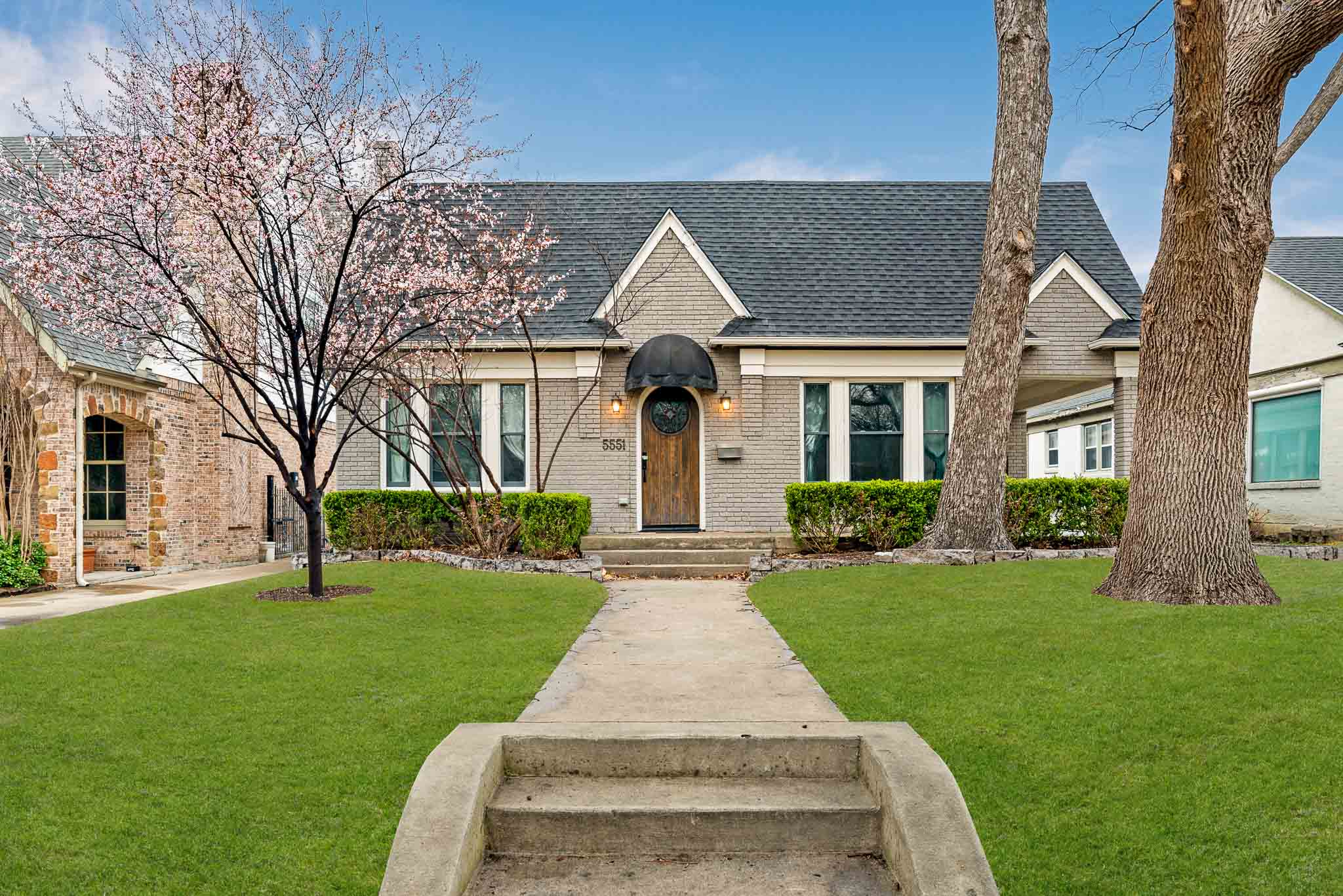 Photo of beautiful Oak Cliff home with green grass