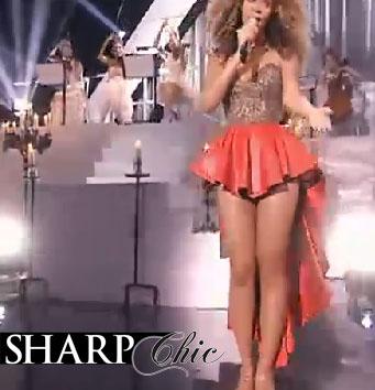 beyonce orange skirt long at back and short front