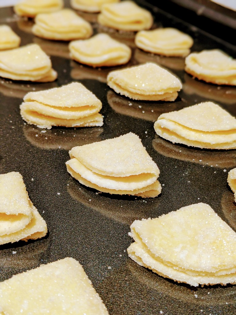 Place sugar side up, and gently press your finger down on each cookie so the layers stick together before putting in oven.