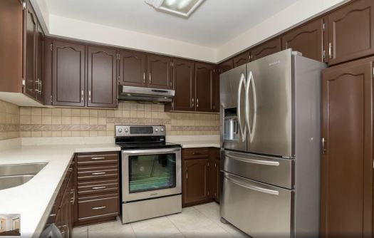 Professionally Spray Painted Kitchen Cabinets