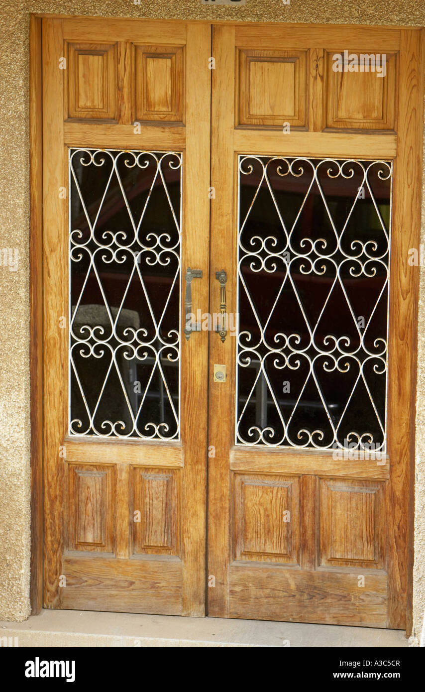 Best Double Wooden Doors With Wrought Iron Decorative Window This Month