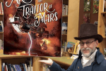 Author wearing steampunk gear holding with augmented reality overlay of his latest novel.