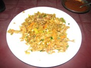 Kottu is roti, vegetables and fish or chicken fried and chopped up by street vendors with special knives on the grill. You can often here the rhytmic beats of kottu being prepared as you walk through Colombo in the evening. (See video)