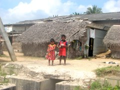 Tamil children outside of their house.