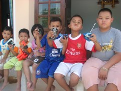 From left to right: Ap, Op, Om, It, Oat, and Oi. Luck's boys, nephews and niece. Three of her sisters and one brother all live on the same plot of land with their families.