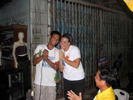 """Here I am presenting Win with a flower wreath after his karaoke performance of a Thai love ballad. All of Ja's family participated in the antics. The night ended with a rousing rendition of """"We are the Champions"""" sung by everyone."""