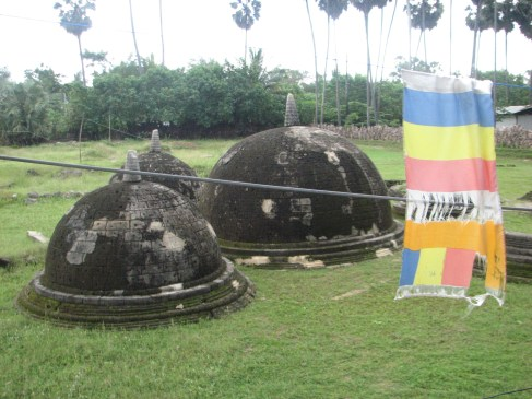 The Buddhist prayer flags hang all over the site - as do the Sri Lanka military,