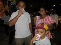 The Sams and Kenula enjoy some free iced tea at a dansala. This kicked off my tour for the evening.