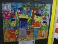 This is vesak through the eyes of a school child. Seems like after hanging a lantern that mans neck will be paining him.