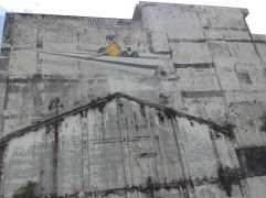 This was one of the murals in Ipoh's Old Town. I like the idea of flying away in a paper airplane.