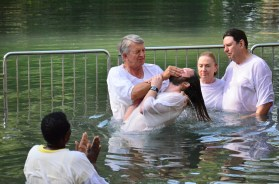 Phil baptizing his son-in-law Daniel in the Jordan River