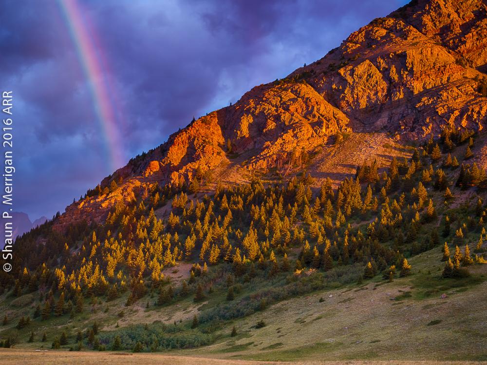 Sunrise rainbow at Waterton Lakes National Park